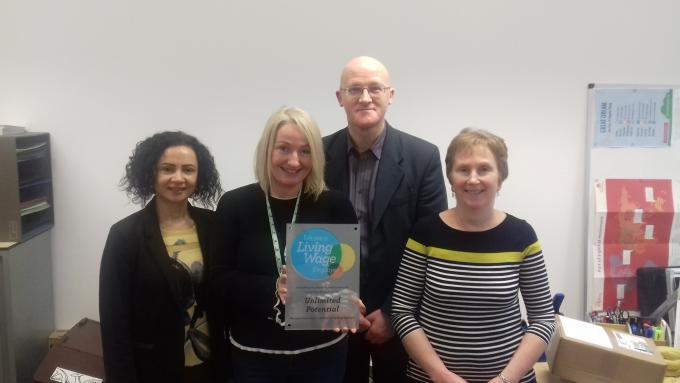 Unlimited Potential Staff posig with their Living Wage Plaque 2018